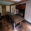 JIM VAIKNORAS/Staff photo The original Coffin family table sits in the Coffin House's original kitchen dating from 1678.