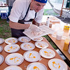 JIM VAIKNORAS/Staff photo Graeme Gilchrist of Brine prepares Dry Sea Scollops at the Sea to Table event at the Custom House in Newburyport.