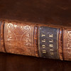 JIM VAIKNORAS/Staff photo One of a number of family bibles at teh Coffin House in Newbury.