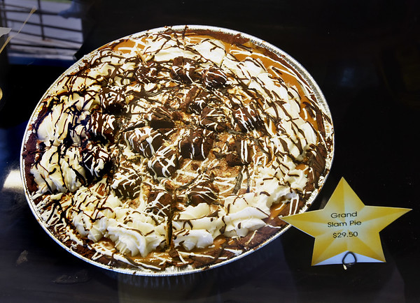 BRYAN EATON/Staff photo.The Grand Slam Pie is cheesecake with brownies, whipped topping, peanut butter and caramel.