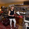 "JIM VAIKNORAS/Staff photo Jen Collins in her home office with a copy of The Kinl Kronackes, one of her late husband's favorite bands Jen has started a foundation ""Tedrock"" to riase money for music education."