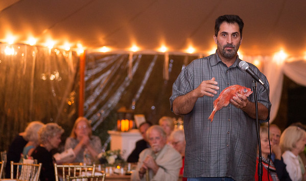 JIM VAIKNORAS/Staff photo Fisherman Paul Vitali on Gloucester talks about the Red Sea perch at the Sea to Table event at the Custom House in Newburyport.