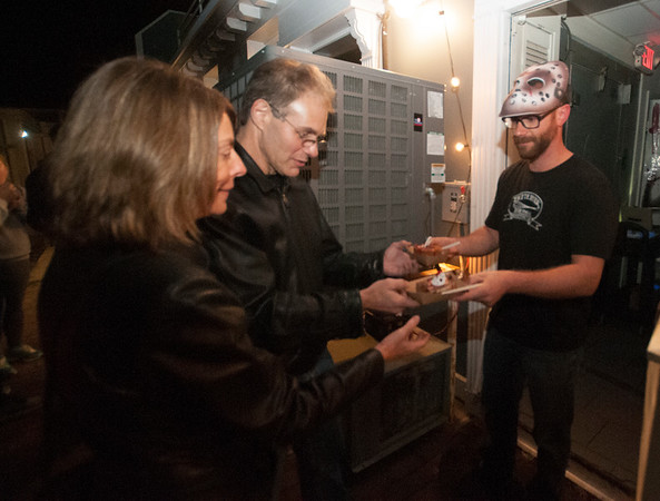JIM VAIKNORAS/Staff photo  Melissa and Elliot Gould of Sandown reseave a dish of Rou Lade from Bryan Dinger at an After dark event at the back door of the Buttermilk Baking Company in Newburyport.