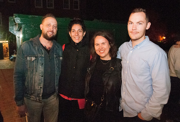 JIM VAIKNORAS/Staff photo Ken and Dana Belanger along with Erin and Tyler Brenneman wait in line for Rou Lade at an After dark event at the back door of the Buttermilk Baking Company in Newburyport.