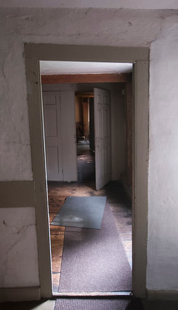JIM VAIKNORAS/Staff photo The doorway into the original kitchen at the Coffin House.