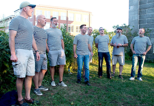 JIM VAIKNORAS/Staff photo The Portermen perform at the Sea to Table event at the Custom House in Newburyport.