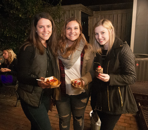 JIM VAIKNORAS/Staff photo Shannon Szypko, Martina Corona, and Kelley Flynn at an After dark event at the back door of the Buttermilk Baking Company in Newburyport.