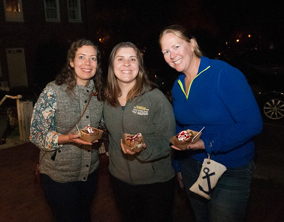 JIM VAIKNORAS/Staff photo  Amy Wilson, Jessica Williams and Jackie Morin at an After dark event at the back door of the Buttermilk Baking Company in Newburyport.