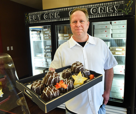 BRYAN EATON/Staff photo. Executive chef Mark Mombello with molton chocolate cakes.