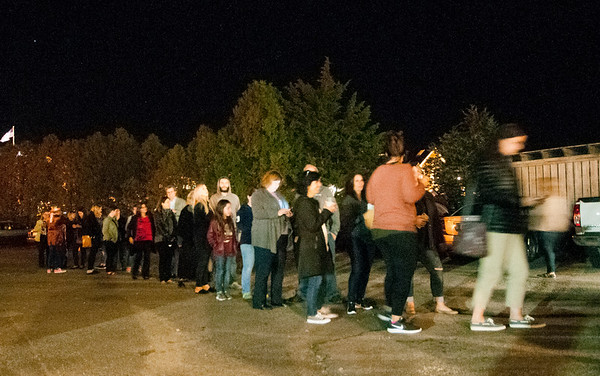 JIM VAIKNORAS/Staff photo About 100 people lined up at an After dark event at the back door of the Buttermilk Baking Company in Newburyport.