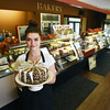 BRYAN EATON/Staff photo. Quianna Poisson shows off an Irish cream mousse in the retail shop of Dianne's Fine Desserts.