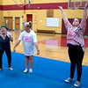 JIM VAIKNORAS/Staff photo Ashley Berhannum, Taryn Lebreck and Jillian Zinck during practice at the Nock Middle School.