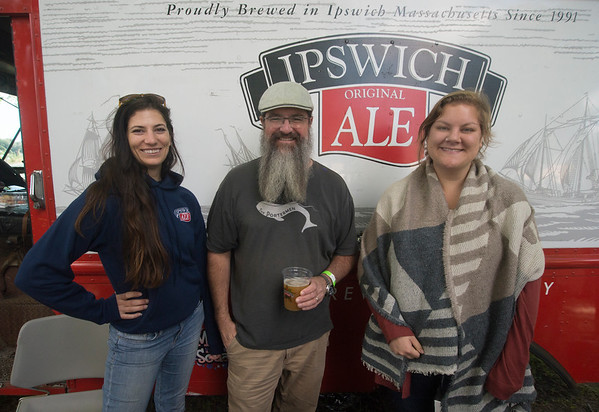 JIM VAIKNORAS/Staff photo Megan Barbas, Jim Dorau, and Emily (no last name given) sell Ipswich Ale at the American Music and Harvest festival at teh Spencer-Peirce-Little Farm in Newbury.