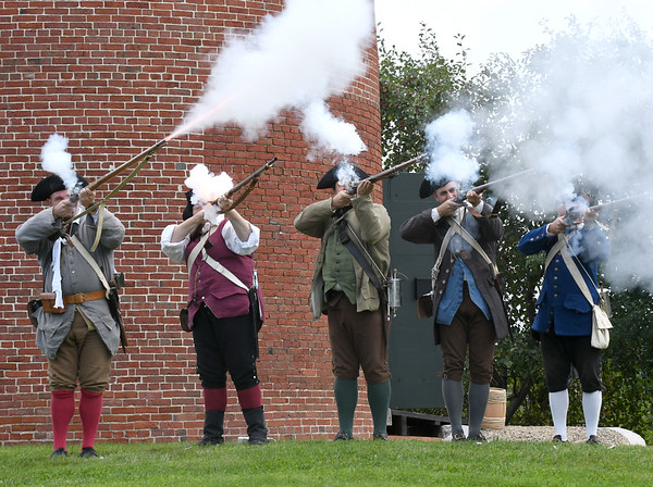 JIM VAIKNORAS/Staff photo Members of the Acton Minutemen, Wayne Niemi, Jennifer Toth, Laurent Dubois, Michael Audette and Steve Crosby fire their flintlock muskets during a demonstration at the Powderhouse in Newburyport Sunday. The event was part of Trails and Sails and was Hosted by Newburyport Preservation Trust. On Sunday the 30th the Powderhouse will be hosting a cooper (barrel maker) and a blacksmith.
