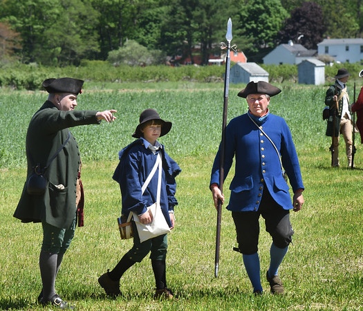BRYAN EATON/Staff photo. Steve Crosby, right, at a Revolutionary War reenactment at the Spencer-Peirce-Little Farm last year.