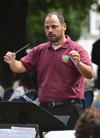 JIM VAIKNORAS/Staff photo Anthony Beatrice conducts the  Merrimack Valley Concert Band  at the Field of Honor during the Sept 11th remembrance ceremony at the Bartlet Mall in Newbburyport.