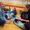 JIM VAIKNORAS/Staff Alex Trimper, Cora Egan, and Maddie Marshall plan a cheering retinue at a practice at the Nock Middle School.