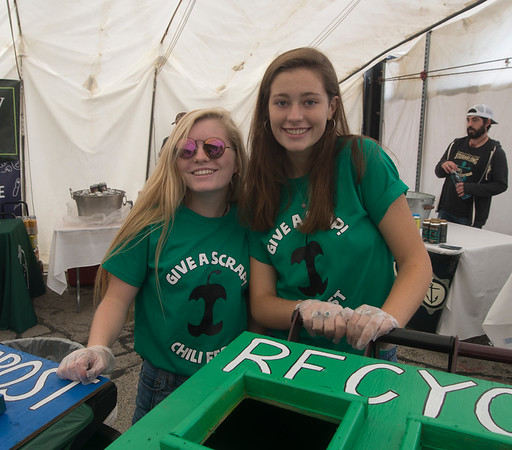 JIM VIKNORAS/Staff photo Sydney Thickell and Jori Guldenstern were part of a group of Newburyport High students who helped out with recycling at The Grog's 11th Annual Chili Cook-Off & Craft Beer Fest at the Tannery in Newburyport.