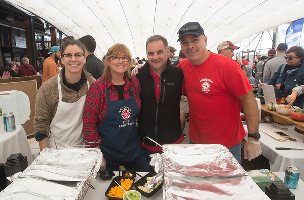JIM VIKNORAS/Staff photo Danielle, Lisa, and Al Deldotto along with Bob Stabile from the Andover Fire Dept at The Grog's 11th Annual Chili Cook-Off & Craft Beer Fest at the tannery in Newburyport.