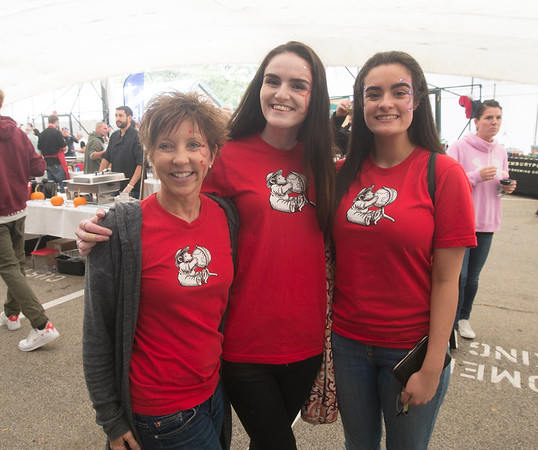 JIM VIKNORAS/Staff photo Brigitte Drew, Jillian Reid and Olivia Valley, who all work at Eureka, at The Grog's 11th Annual Chili Cook-Off & Craft Beer Fest at the tannery in Newburyport.