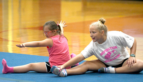 JIM VAIKNORAS/Staff photo Claire Doran and Taryn Lebreck stretch during practice at the Nock Middle School.