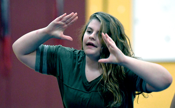 JIM VAIKNORAS/Staff photo Jaclyn Zink does a cheer at practice at the Nock Middle school in Newburyport.