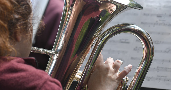 JIM VAIKNORAS/Staff photo Euphonium player Valerie Hermanson performs with the  Merrimack Valley Concert Band  at the Field of Honor during the Sept 11th remembrance ceremony at the Bartlet Mall in Newbburyport.