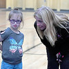 JIM VAIKNORAS/Staff photo Advisor Alison Trimper talks with Sarina Flynn during a practice at the Nock Middle School in Newburyport.