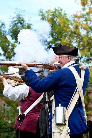 JIM VAIKNORAS/Staff photo Steve Crosby with the Acton Minutemen fire their flintlock muskets during a demonstration at the Powderhouse in Newburyport Sunday. The event was part of Trails and Sails and was Hosted by Newburyport Preservation Trust.