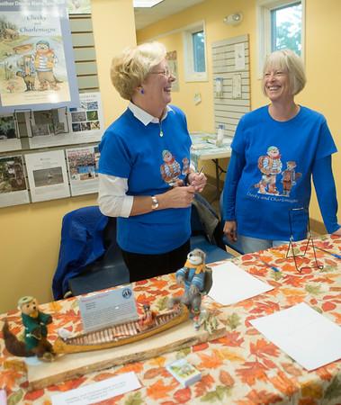 JIM VAIKNORAS/staff photo Author Donna Seim and illustrator Susan Spellman at a reception at the Joppa Flats Education Center.
