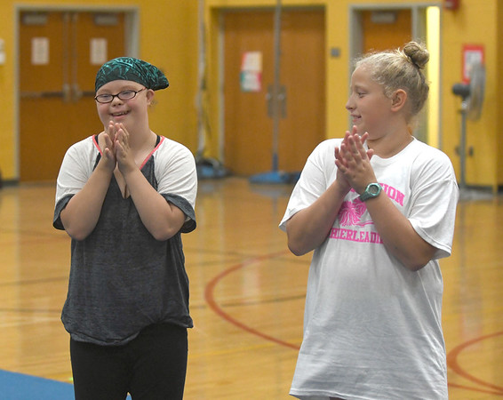 JIM VAIKNORAS/Staff photo Ashley Berhannum and, Taryn Lebreck during practice at the Nock Middle School.
