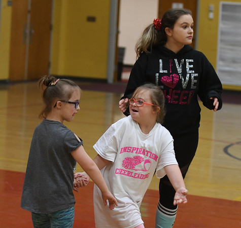 JIM VAIKNORAS/Staff photo Sabrina Flynn. Claire Doran and Maddie Marshall during practice at the Nock Middle School.
