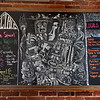 "BRYAN EATON/Staff photo. Blackboard with wine specials and ""locals only"" referring to local beers on tap."