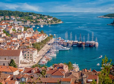 Summer resort lifestyle. Overlooking the yacht harbor and picturesque waterfront of Hvar Island, on the Adriatic Coast in Croatia.