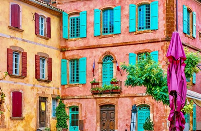 Beautiful, colorful building facades made from locally mined ochre, in the picturesque French village of Roussillon.