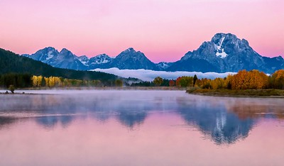 Beautiful alpenglow in the Teton mountain range at dawn.