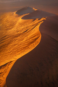 Aerial view of a large red sand dune in the Namib Desert.