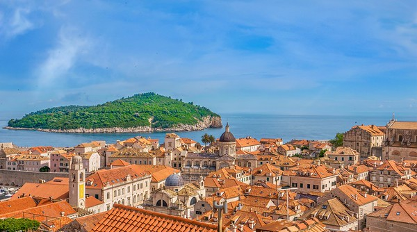 The Old Town in Dubrovnik, with green Lokrum Island in the Adriatic Sea.