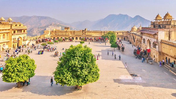 The courtyard of the 16th century Amer Fort, as tourists arrive on elephants and gather for sightseeing tours of its sandstone and marble buildings.
