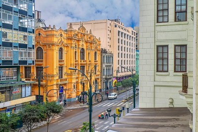 A downtown street in Lima, with its mixture of architectural design styles.