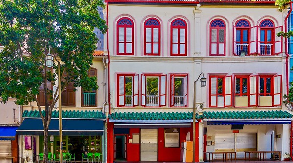 A bright and colorful building facade in Singapore's Chinatown.