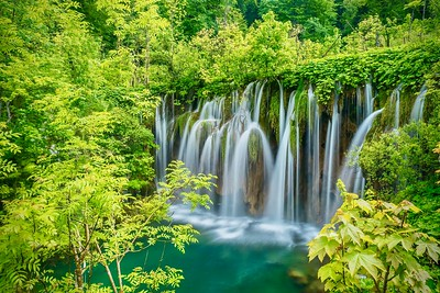 Gorgeous waterfalls in a springtime forest.