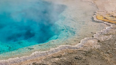 Close-up of the outer edge of a steaming hot spring.