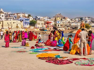 Indian Hindu religious pilgrims gathered beside Pushkar Lake.