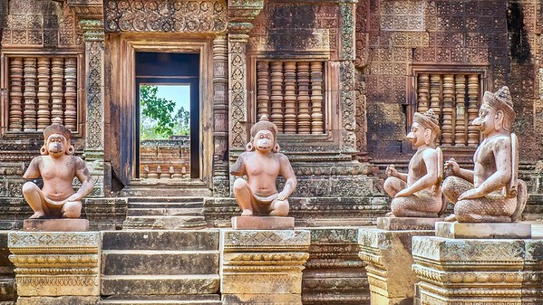 Statues of human figures with animal heads at the entrance to the 10th century Banteay Srei temple at Angkor Wat in Siem Reap, Cambodia. These are replicas to replace damaged, vandalized or stolen originals.