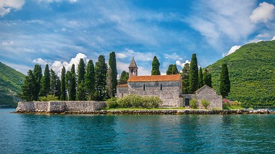 A small 12th century Benedictine monastery on the tiny island of St. George, near the town of Perastin, in the beautiful Bay of Kotor. Montenegro.