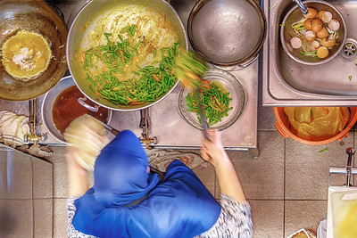 Malay food being cooked in a food stall in Little India, Singapore