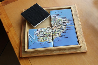 Sublimation tile work.  The special frame is made by Maples.  The tiles are used as drink coasters.