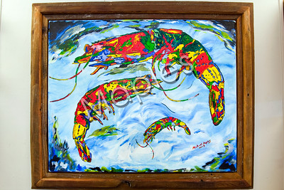 3 playful shrimp, acrylic painting on canvas by Maples framed in his reclaimed frame.