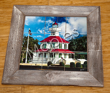 "Painting and then printed of the ""Old Light"" on the Lakefront in New Orleans.  My frame."